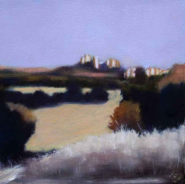 Landscape with wheatfields and a hilltop village in Provence, South of France